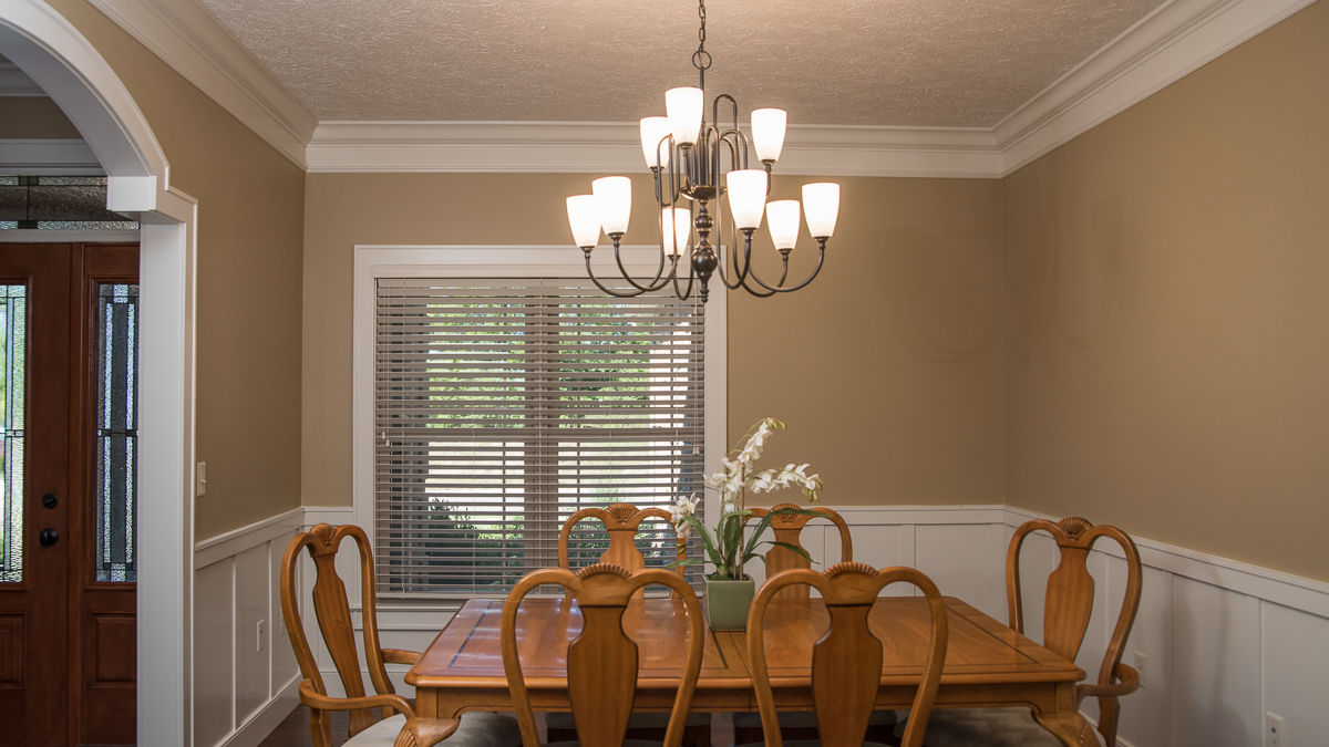 Barrington model dining room feature custom arches and wainscotting