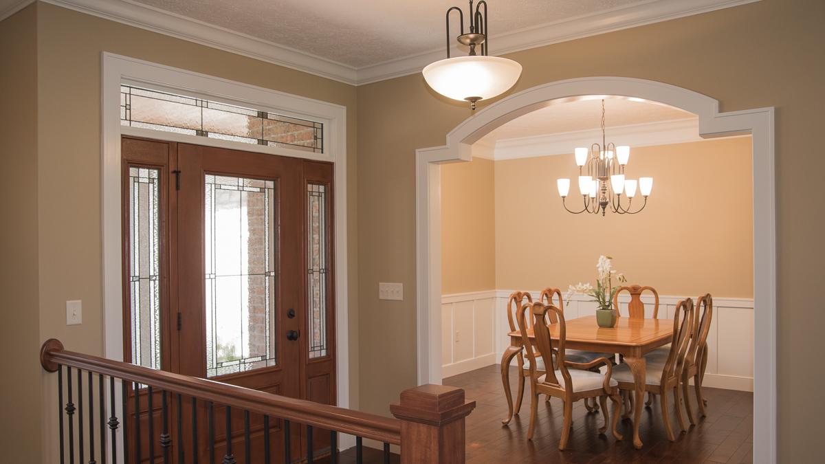 Barrington model foyer and dining room feature custom arches and wainscotting