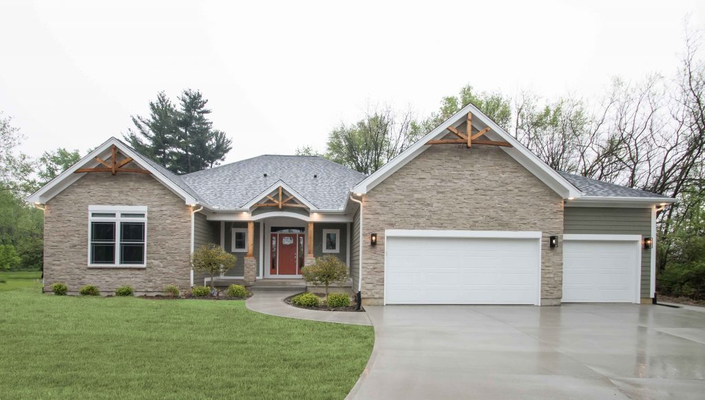 Excalibur with Arizona Dry Stack stone, LP Smart Siding painted SW7061 Night Owl, and gable accents