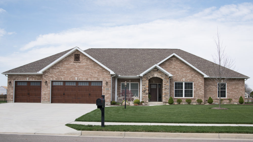 Glendale Model modified with Natural Blend Weather Ledge stone stoop and brick exterior built in the Meadows of Stonebridge (Troy)