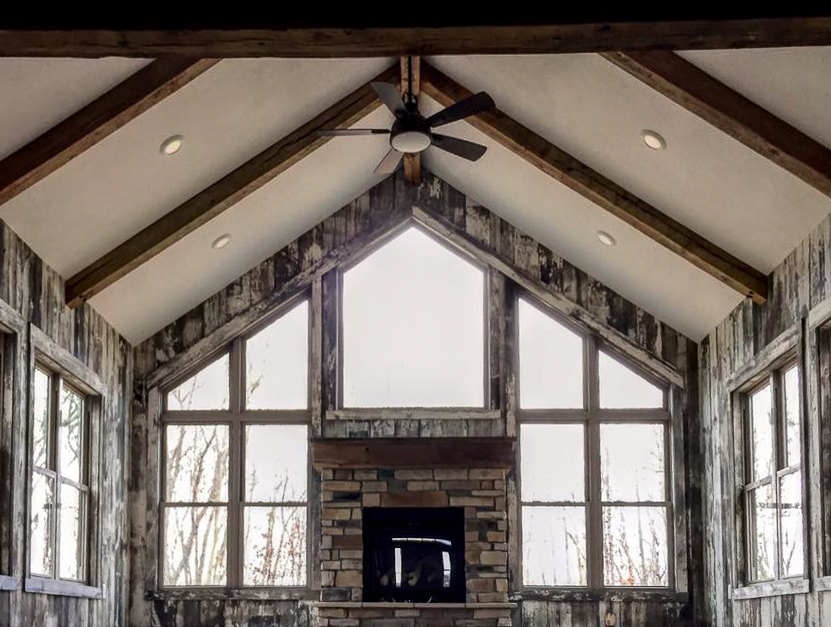 Reclaimed barn wood used in this great room makes for a truly authentic rustic feel