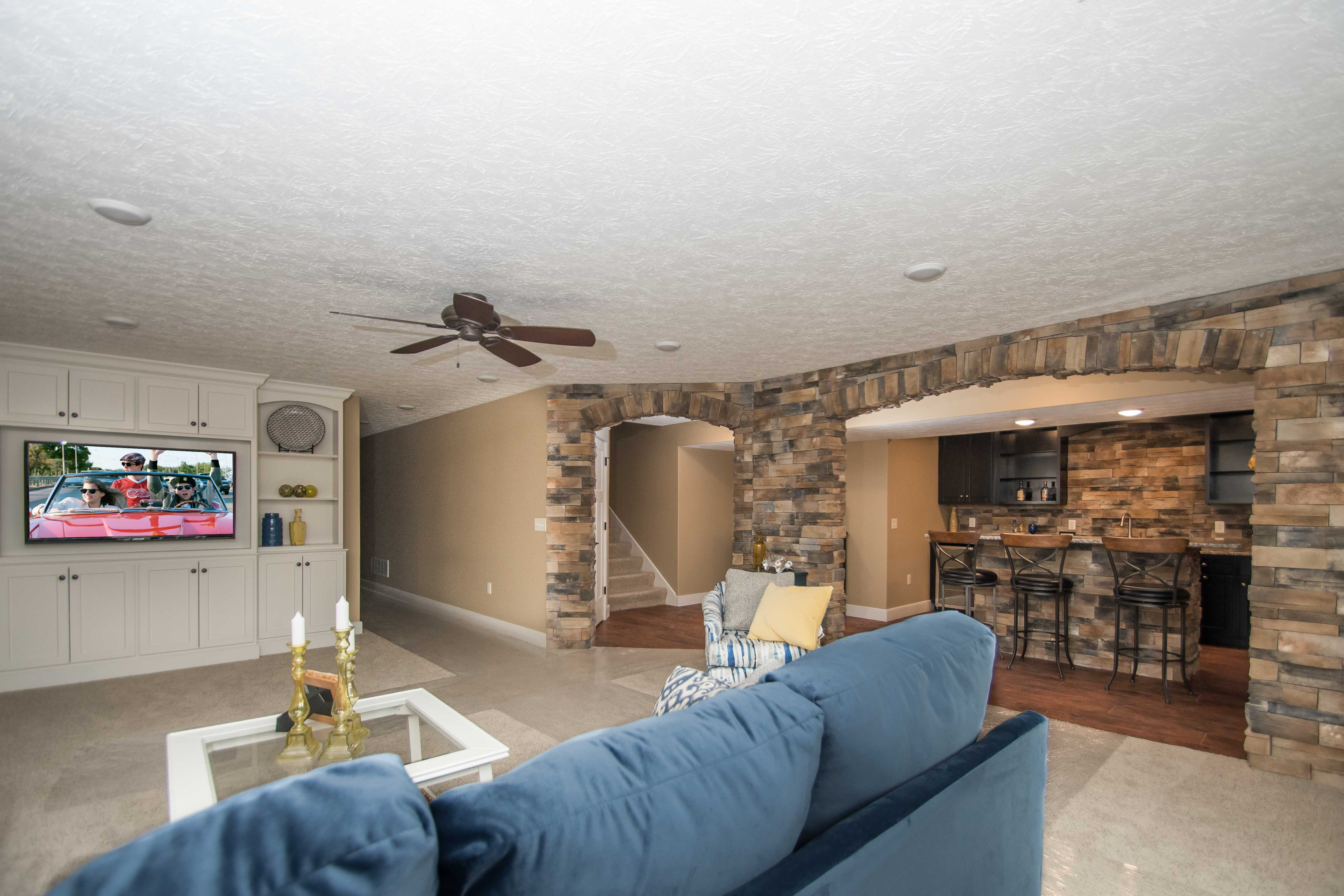 Basement of Windmill model with Luxury vinyl flooring: Moduleo Eastern Hickory 57550, Sienna Dry Stack stone and custom built ins