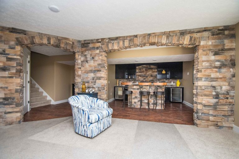 Basement of Windmill model with Luxury vinyl flooring: Moduleo Eastern Hickory 57550, Sienna Dry Stack stone