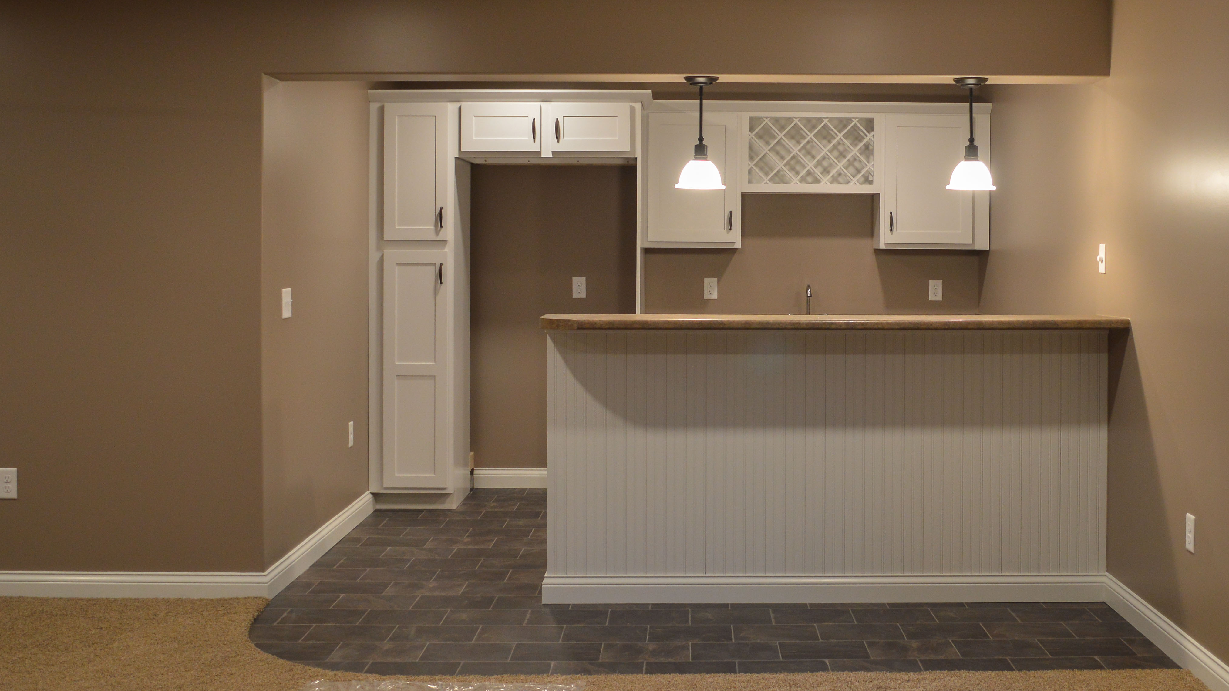 White cabinets and bar back
