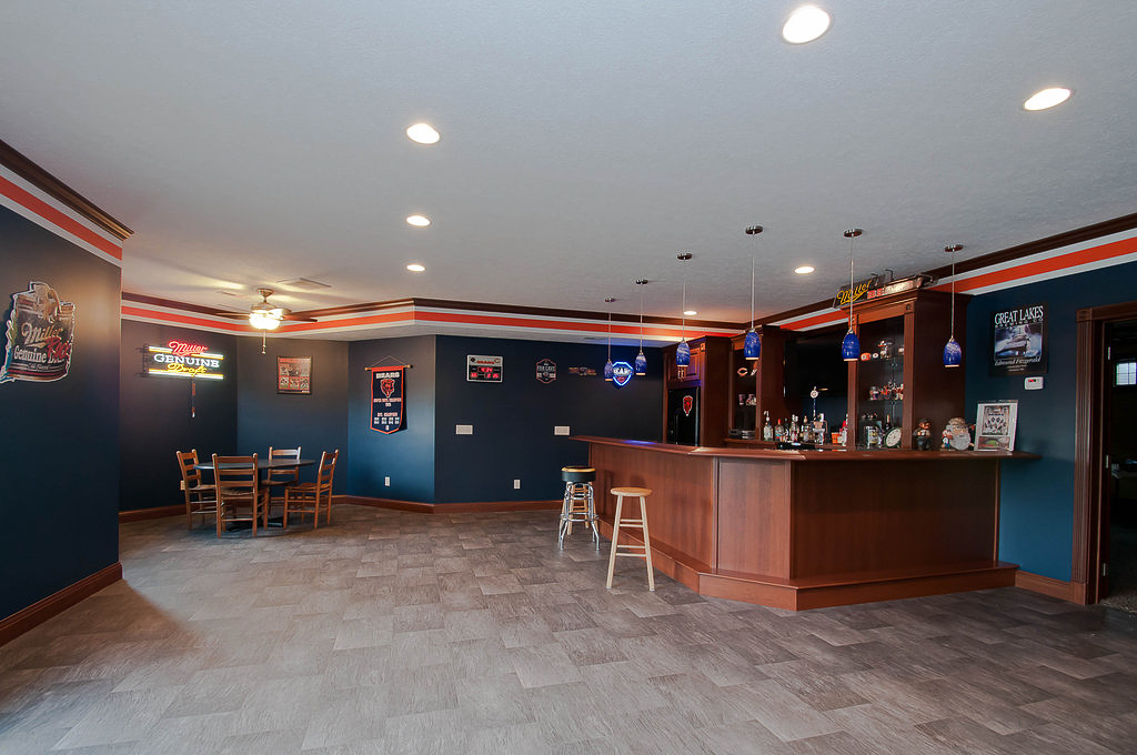 Walk out basement features fully functioning bar decked out in Bears attire!