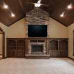 Gas fireplace with Cypress Dry Stack stone, raised hearth and glass-door component boxes in stained mantle