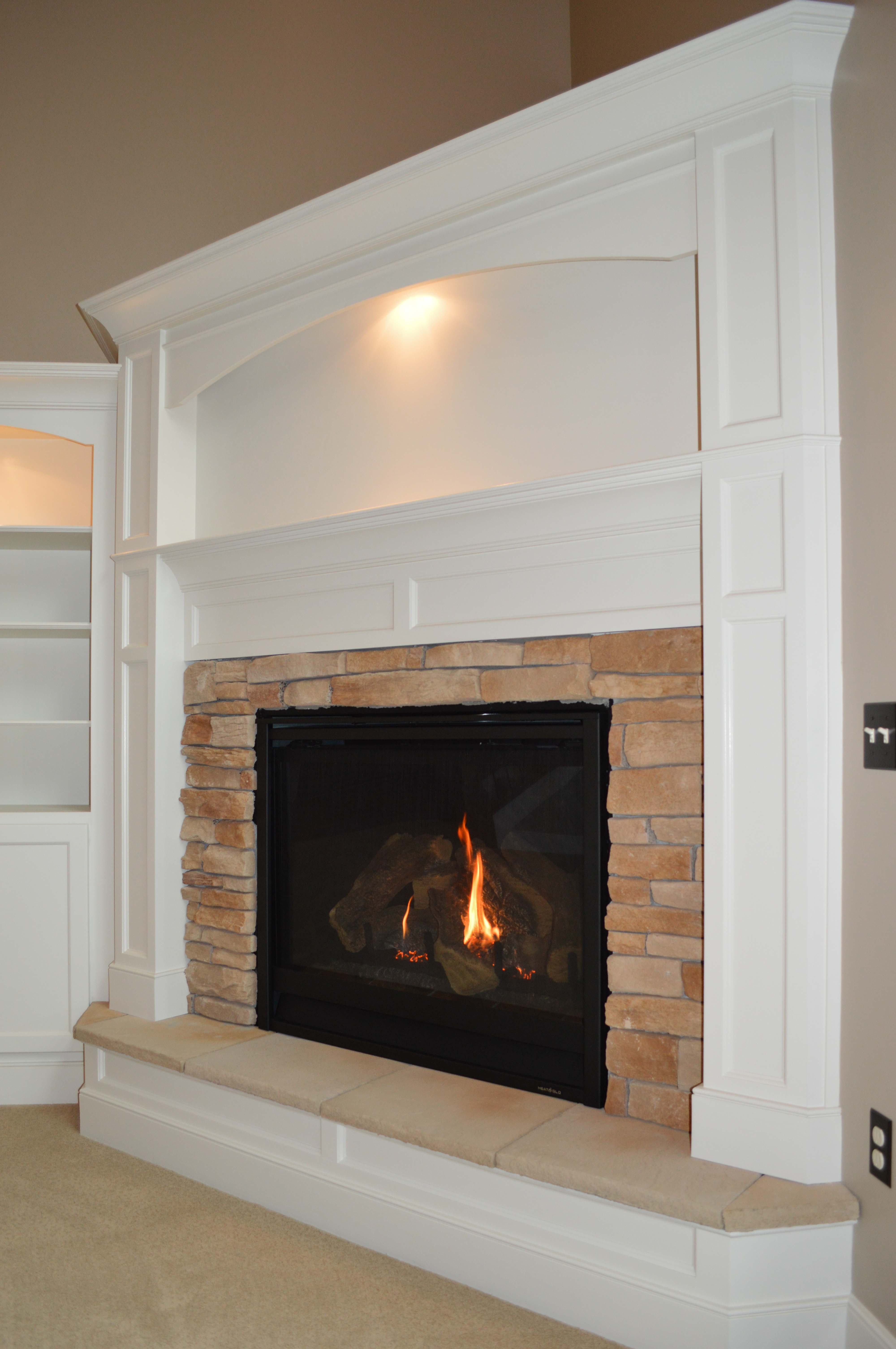 Gas corner fireplace with raised hearth and Tan Stackledge stone