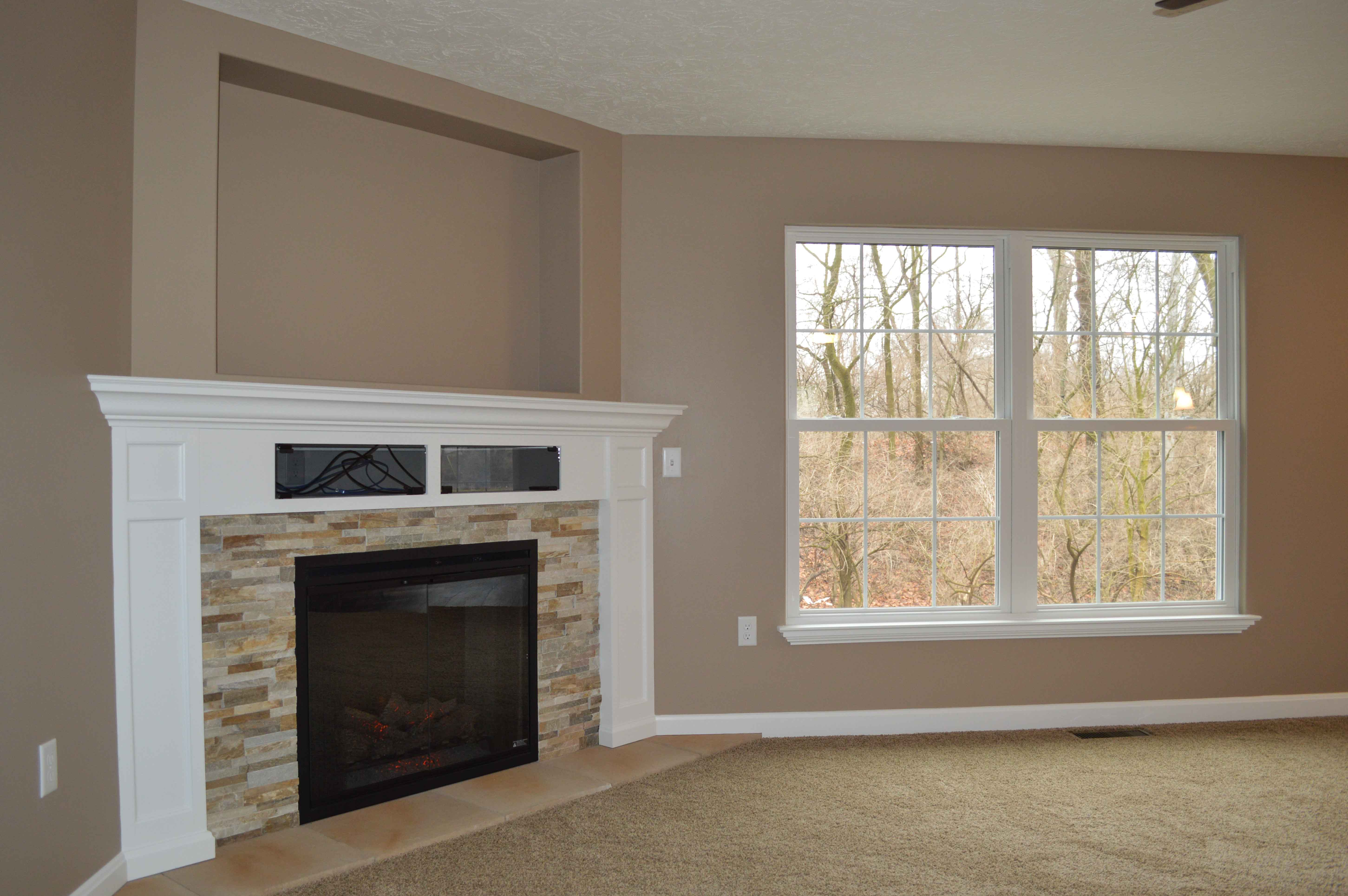Corner gas fireplace with glass-door component boxes in surrounding trim