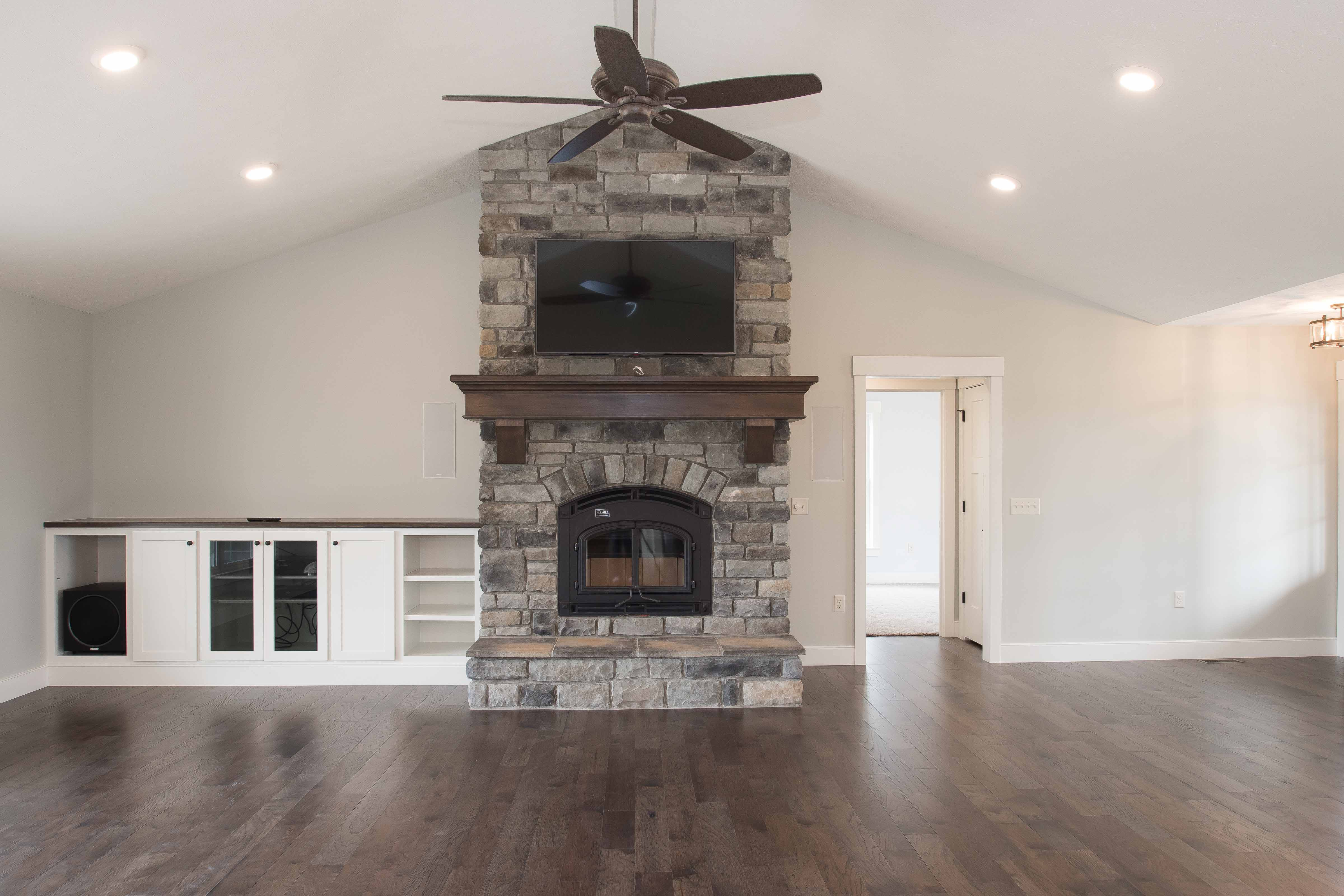 Quadrafire 7100 Wood Burning Fireplace, Mission Hill front with all black trim, raised hearth, Elkwood Limestone