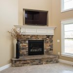 Electric fireplace, raised hearth, Sienna Dry Stack stone, component box in mantle