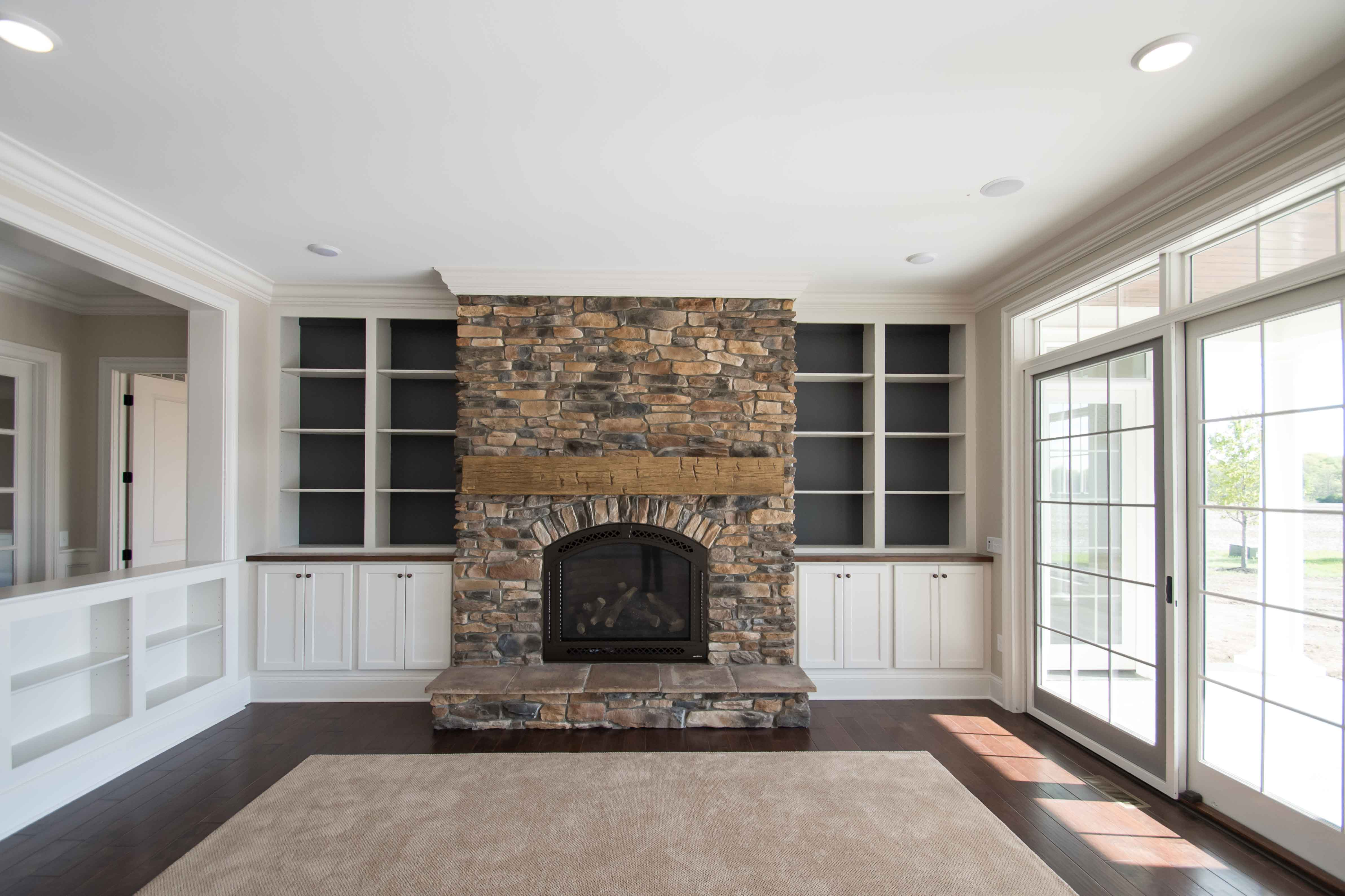 "42"" Propane fireplace, Cerona-42, new bronze, with Chateau Deluxe front. Sienna Ledge Stone, hand hewed wood beam for mantle"