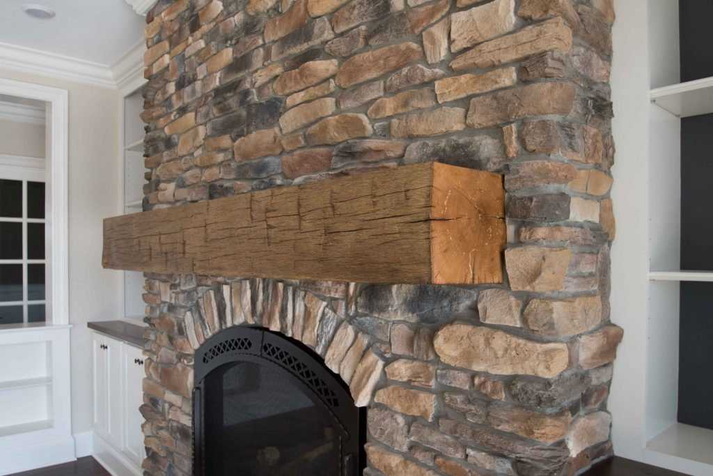 """42"""" Propane fireplace, Cerona-42, new bronze, with Chateau Deluxe front. Sienna Ledge Stone, hand hewed wood beam for mantle"""