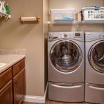 Drop in sink with lower cabinets, wire hang shelving