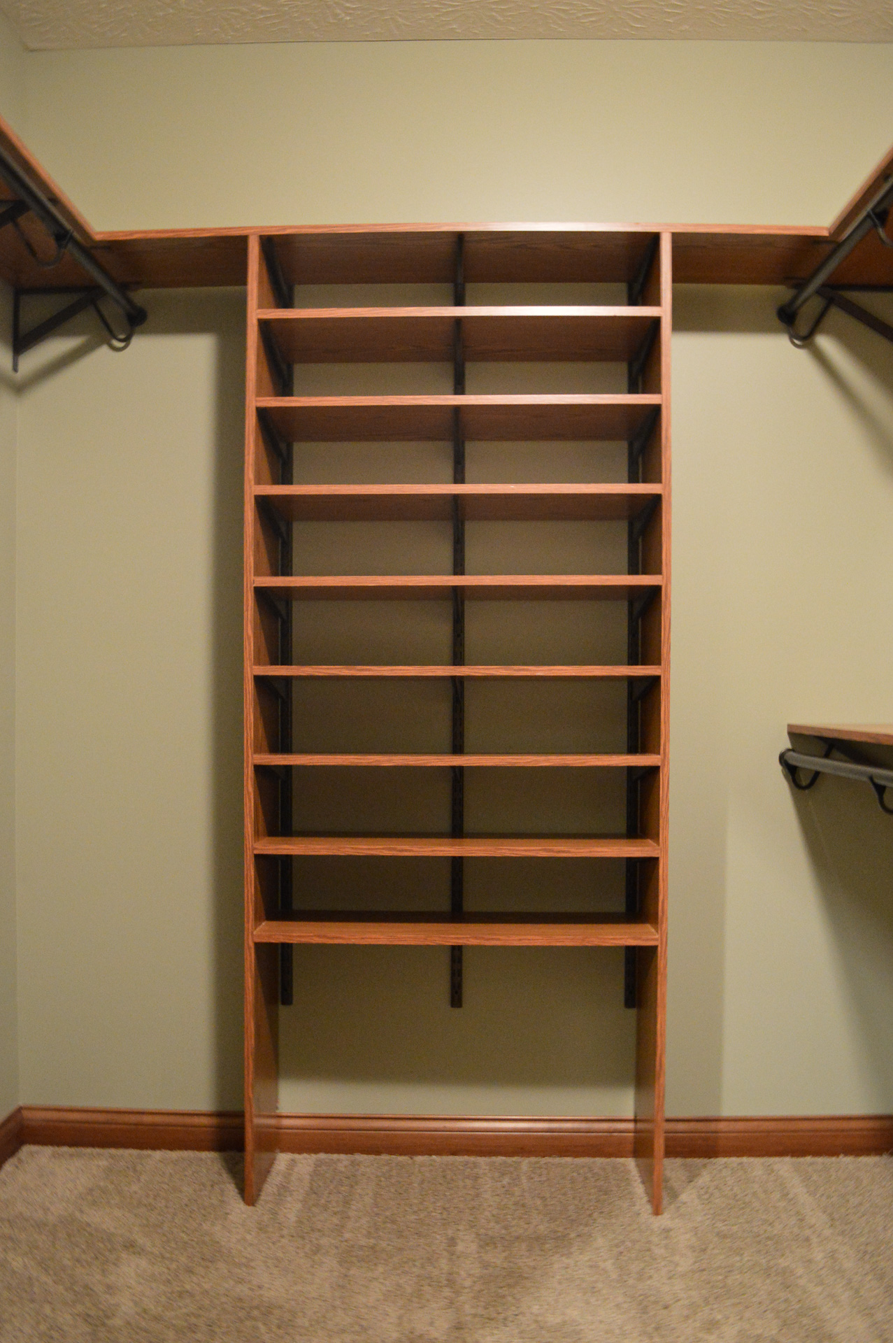 Laminate Wood shelving in master closet