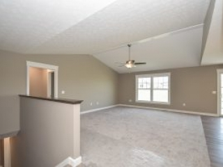 Great room with cathedral ceiling in Fenway model